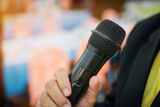 seminar-conference-concept-hands-business-people-holding-microphones-for-speech-speaking_4236-1113.jpg